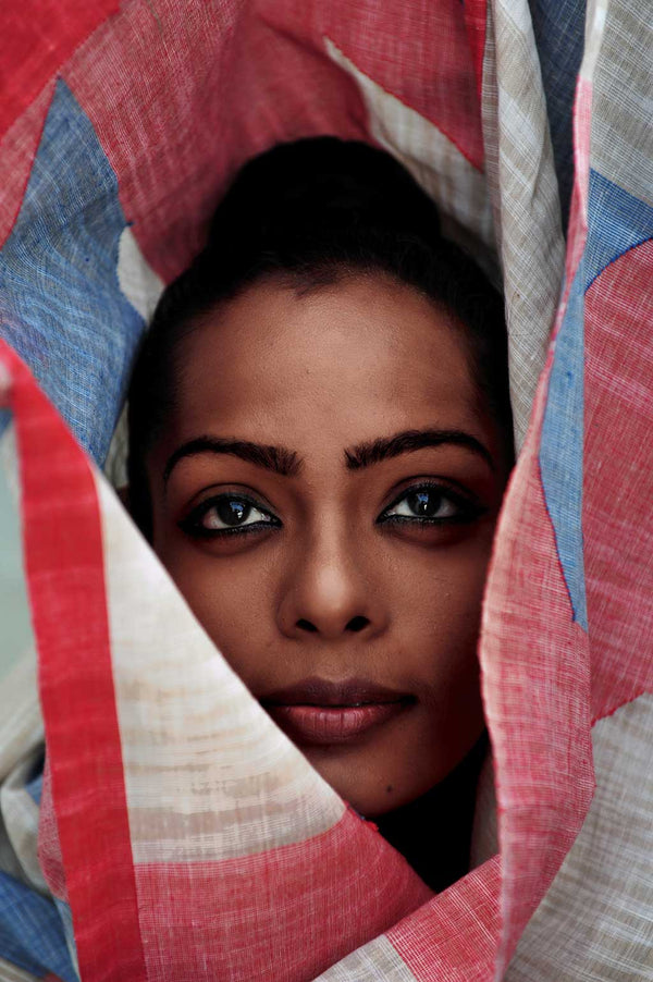 face of Kamakshi Saxena looking through wrapped in Khadi Jamdani Red Blue Saree