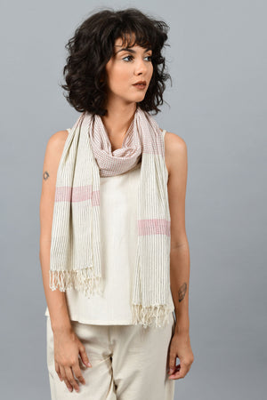 Model wearing off-white homespun and handwoven fine cotton stole printed with read and blue stripes around her neck