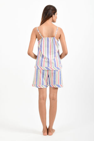 Back pose of an Indian female womenswear fashion model in azo-free candy colour striped, handspun and handwoven khadi cotton spaghetti top and boxers by Cotton Rack.