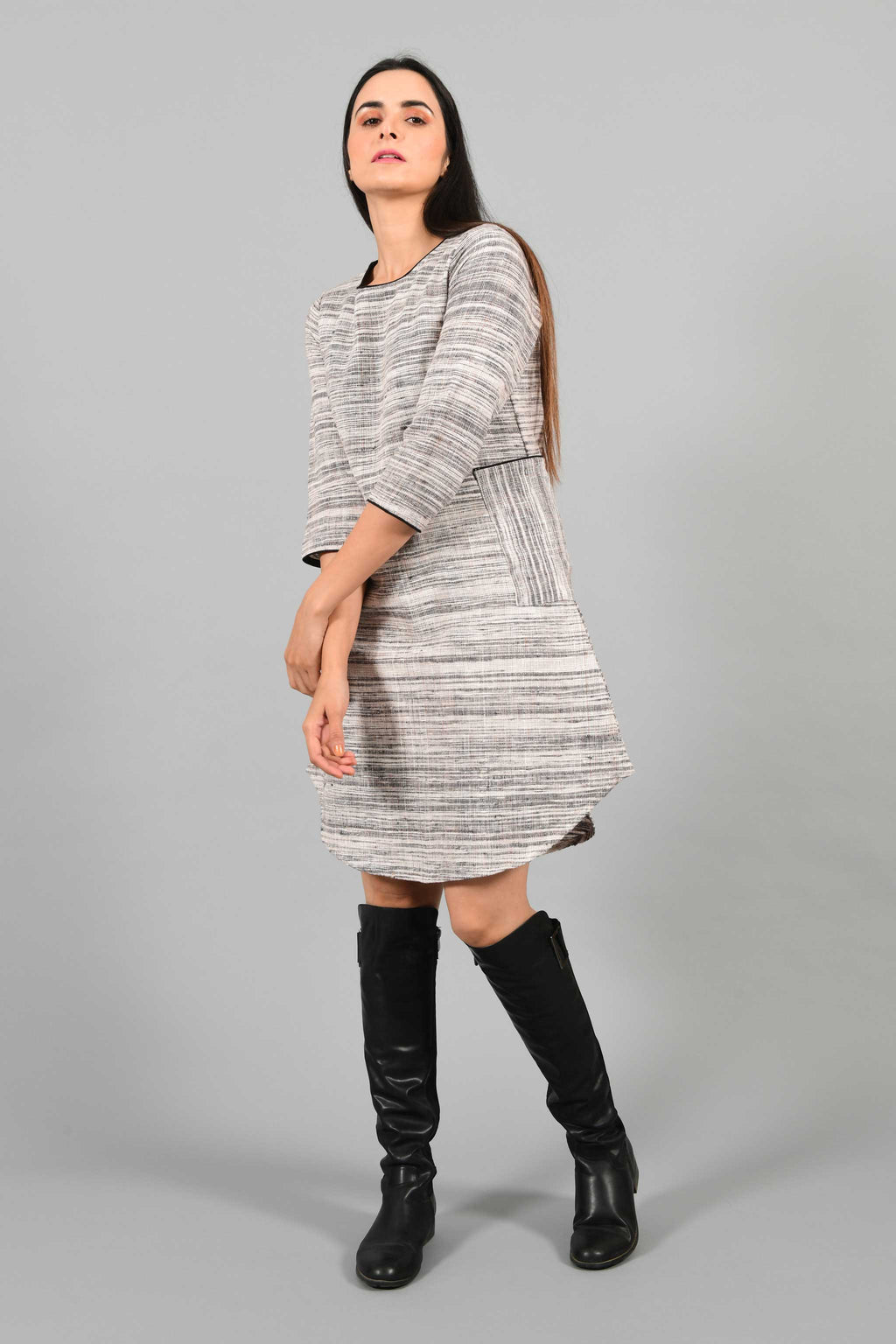 Front pose of an Indian Womenswear female model wearing Beige Brown handspun and handwoven cotton dress by Cotton Rack.