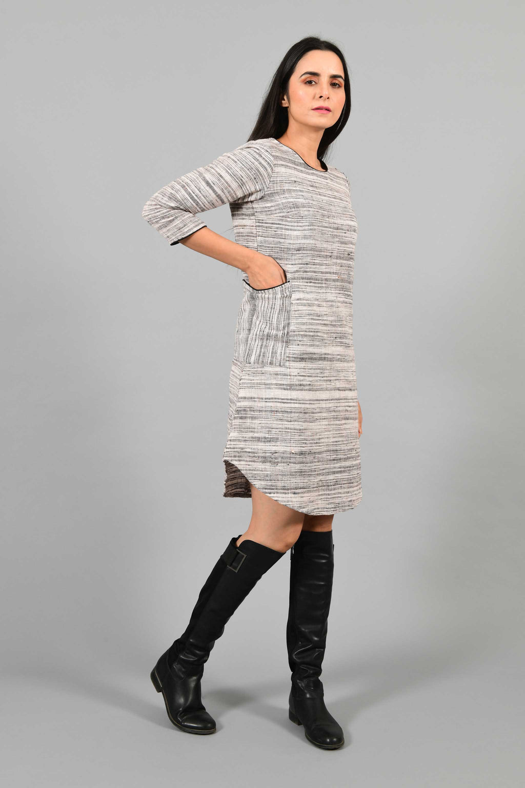 Side pose of an Indian Womenswear female model wearing Beige Brown handspun and handwoven cotton dress by Cotton Rack.