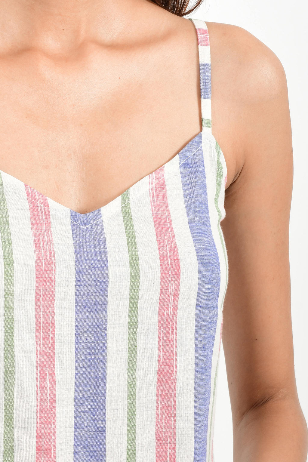 Close-Up of an Indian female womenswear fashion model in an mutli colored striped handspun and handwoven khadi cotton spaghetti dress by Cotton Rack.