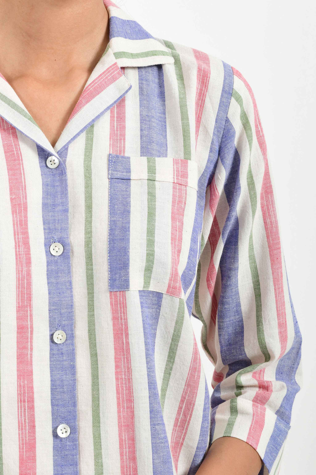 Close-up of an Indian female womenswear fashion model in a candy colored striped azo-free dyed handspun and handwoven khadi cotton nightwear pyjama & shirt by Cotton Rack.