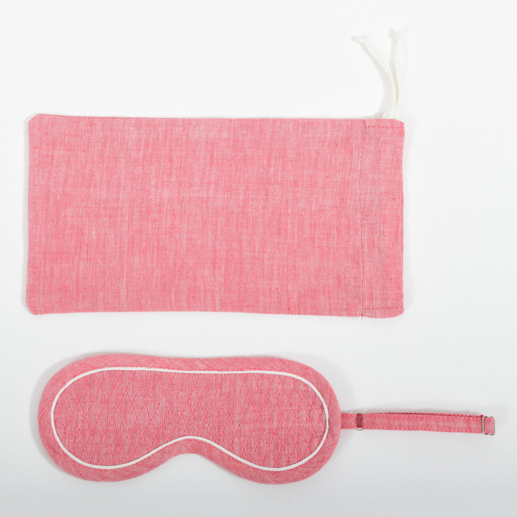 A close-up image from the top of the pink chambray eye mask and it's co-ordinated cover made in handspun and handwoven khadi cotton by Cotton Rack.