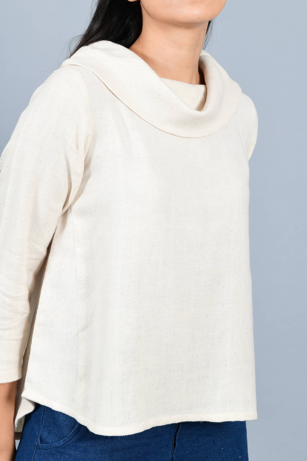 Close Up of an Indian female womenswear fashion model in an off-white Cashmere Cotton Top with cowl neck and quarter sleeves made using handspun and handwoven khadi cotton by Cotton Rack.