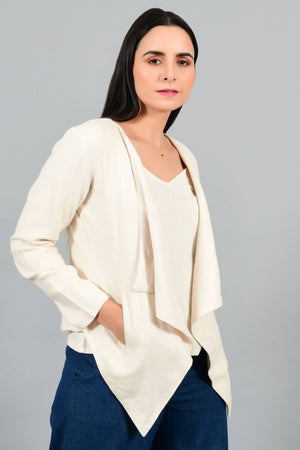 Close Up of an Indian female womenswear fashion model in a short off-white Cashmere Cotton jacket-shrug with extra wide lapels, made using handspun and handwoven khadi cotton by Cotton Rack.