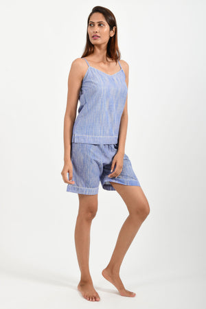 Front pose of an Indian female womenswear fashion model in azo-free space dyed blue handspun and handwoven khadi cotton spaghetti top and boxers by Cotton Rack.