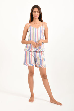 Front pose of an Indian female womenswear fashion model in azo-free candy colour striped, handspun and handwoven khadi cotton spaghetti top and boxers by Cotton Rack.