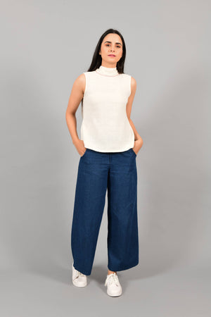 Front pose of an Indian female womenswear fashion model in an off-white Cashmere Cotton Top with a bow collar made with handspun and handwoven khadi cotton by Cotton Rack.