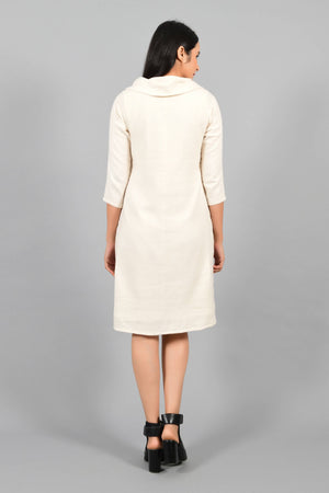 Back pose of an Indian female womenswear fashion model in an off-white Cashmere Cotton Cowl Neck Dress made using handspun and handwoven khadi cotton by Cotton Rack.