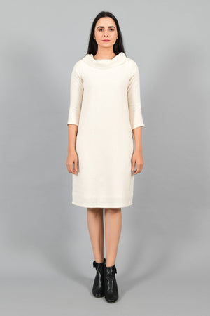 Front pose of an Indian female womenswear fashion model in an off-white Cashmere Cotton Cowl Neck Dress made using handspun and handwoven khadi cotton by Cotton Rack.