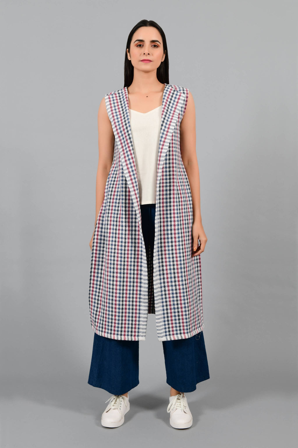 Front pose of an Indian Womenswear female model wearing Red and Blue handspun and handwoven khadi long Jacket over an off-white cashmere cotton dress by Cotton Rack.