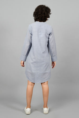 back of a model wearing a grey shirt dress with fine checks in fine handspun handwoven khadi cotton from west bengal