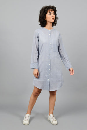 front of a model wearing a grey shirt dress with fine checks in fine handspun handwoven khadi cotton from west bengal