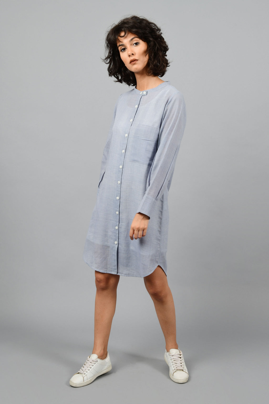 side pose of a model wearing a grey shirt dress with fine checks in fine handspun handwoven khadi cotton from west bengal