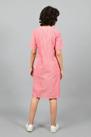 back of a model wearing a straight fit boat neck dress in fine handspun handwoven khadi cotton from west bengal
