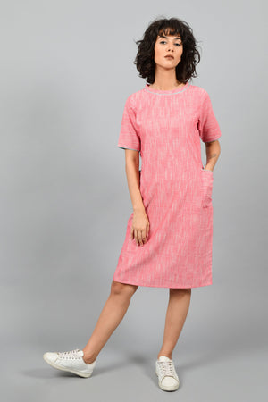 front of a model wearing a straight fit boat neck dress in fine handspun handwoven khadi cotton from west bengal