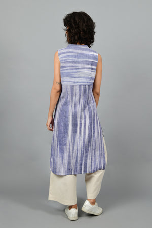 back of a model wearing a long jacket in blue and white space dyed thicker handspun handwoven khadi cotton from lucknow