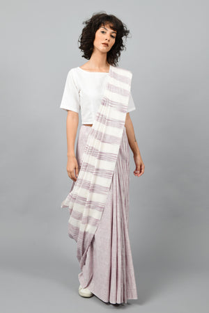 Front pose of a female womenswear fashion model draped in a purple & white space dyed homespun and handwoven cotton saree by Cotton Rack.