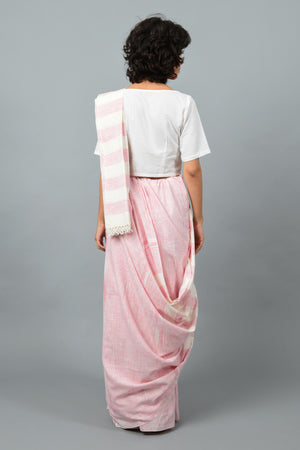back pose of a female womenswear fashion model draped in a pink & white space dyed homespun and handwoven cotton saree by Cotton Rack.