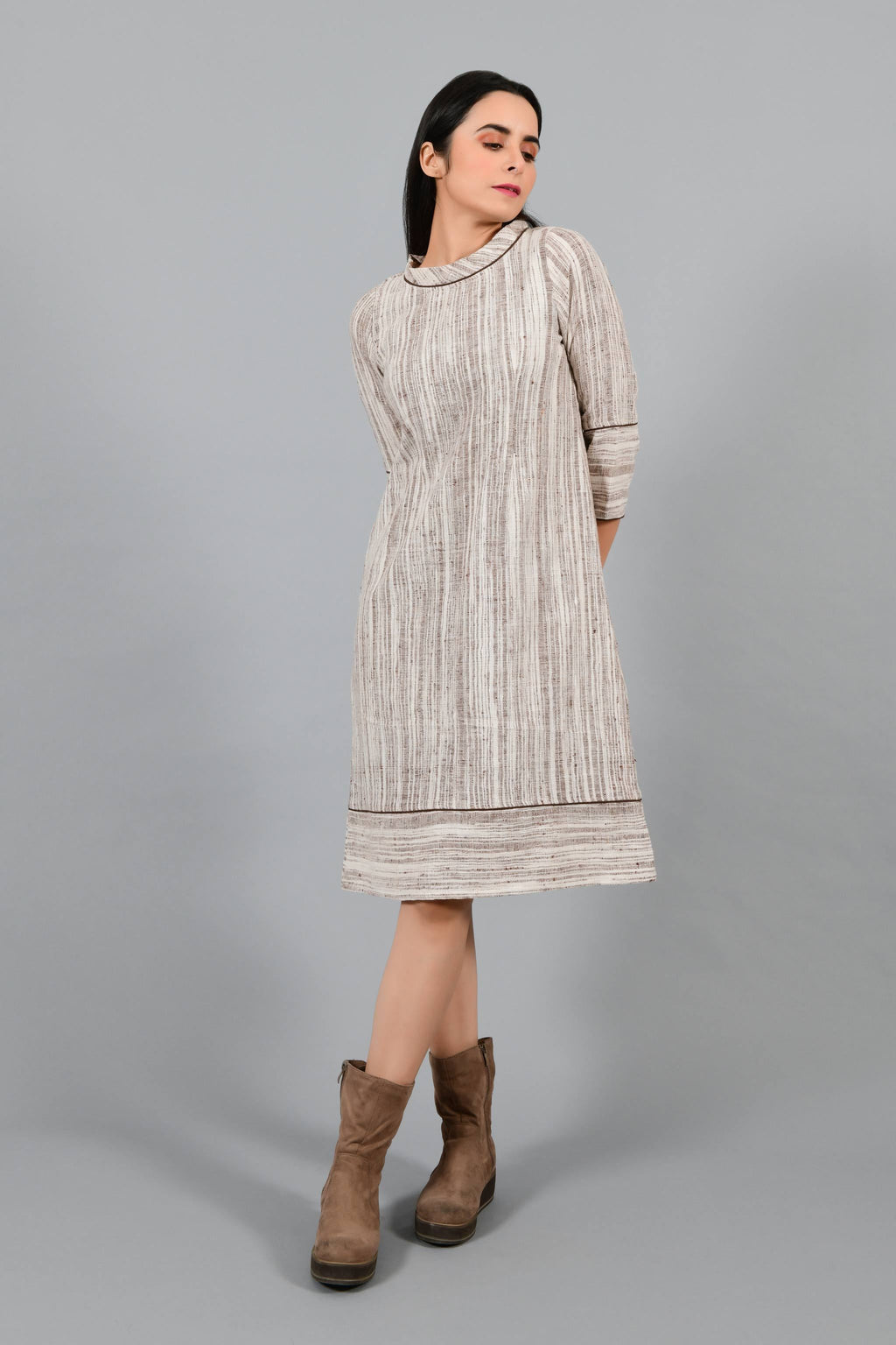 Front pose of an Indian Womenswear female model wearing brown handspun and handwoven cotton a-line dress by Cotton Rack.