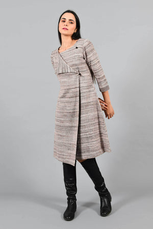 three-quarter front pose of an Indian Womenswear female model wearing brown-black textured handspun and handwoven cotton angrakha dress by Cotton Rack with black boots.
