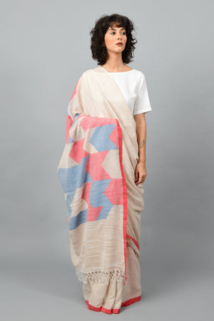 Front pose of a female womenswear fashion model draped in a Beige red & blue Jamdani space dyed homespun and handwoven 100s cotton sari by Cotton Rack.