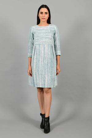 Front pose of an Indian Womenswear female model wearing pine green handspun and handwoven cotton dress by Cotton Rack.