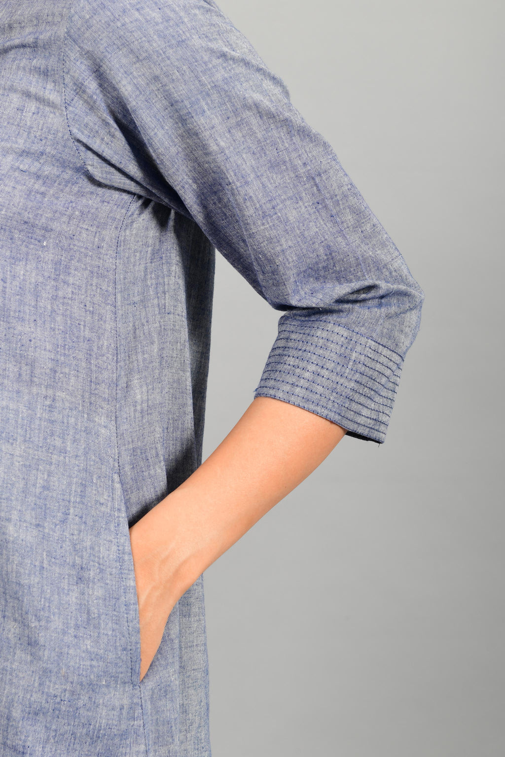 Close up of details of blue chambray handspun and handwoven khadi cotton dress-kurta by Cotton Rack.