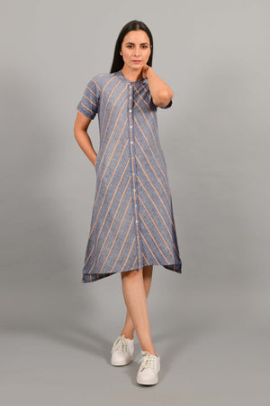 Front pose of an Indian female womenswear fashion model in a Blue chambray with orange stripes handspun and handwoven khadi cotton dress-kurta by Cotton Rack.