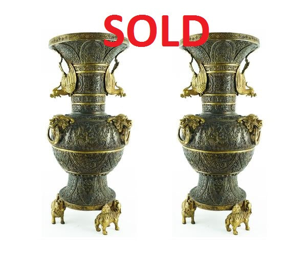 Pair of Chinese Bronze Vases with Parcel-Gilt Features
