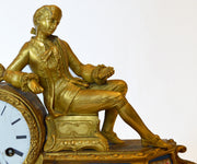 Gilded bronze and sevres clock with a figurin