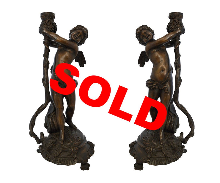 Pair of Tall Bronze Cherub Candle holders
