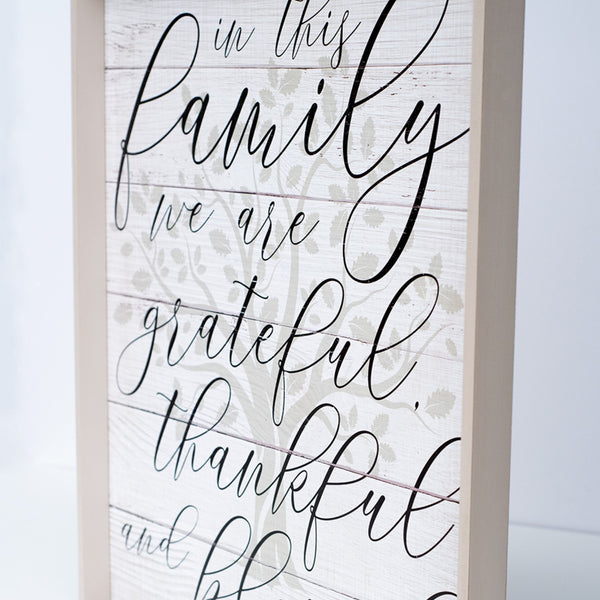 in this family | wood-framed sign