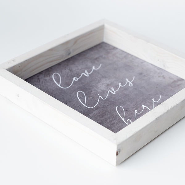 love lives here | wood-framed sign