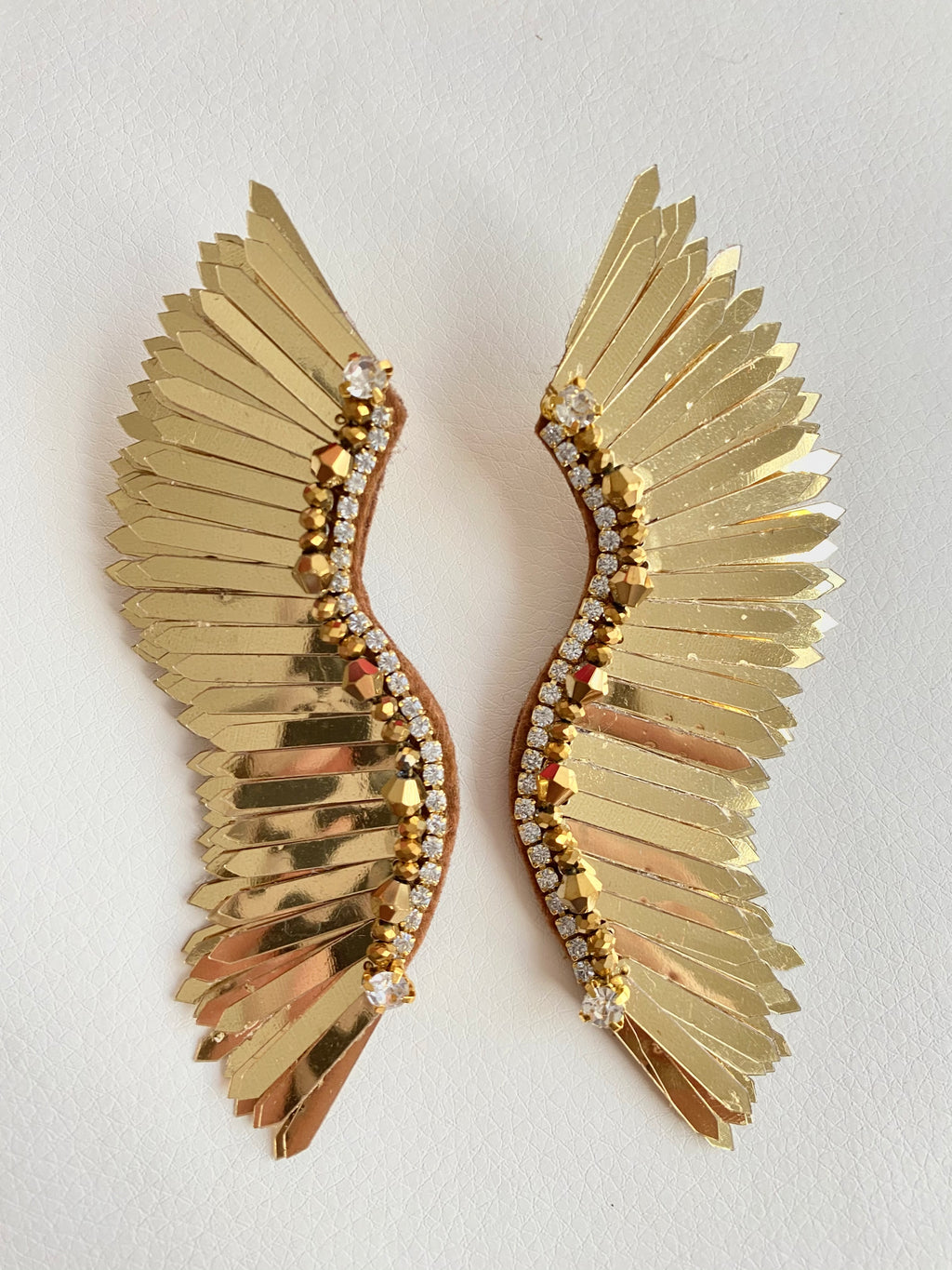 Large gold wing earrings