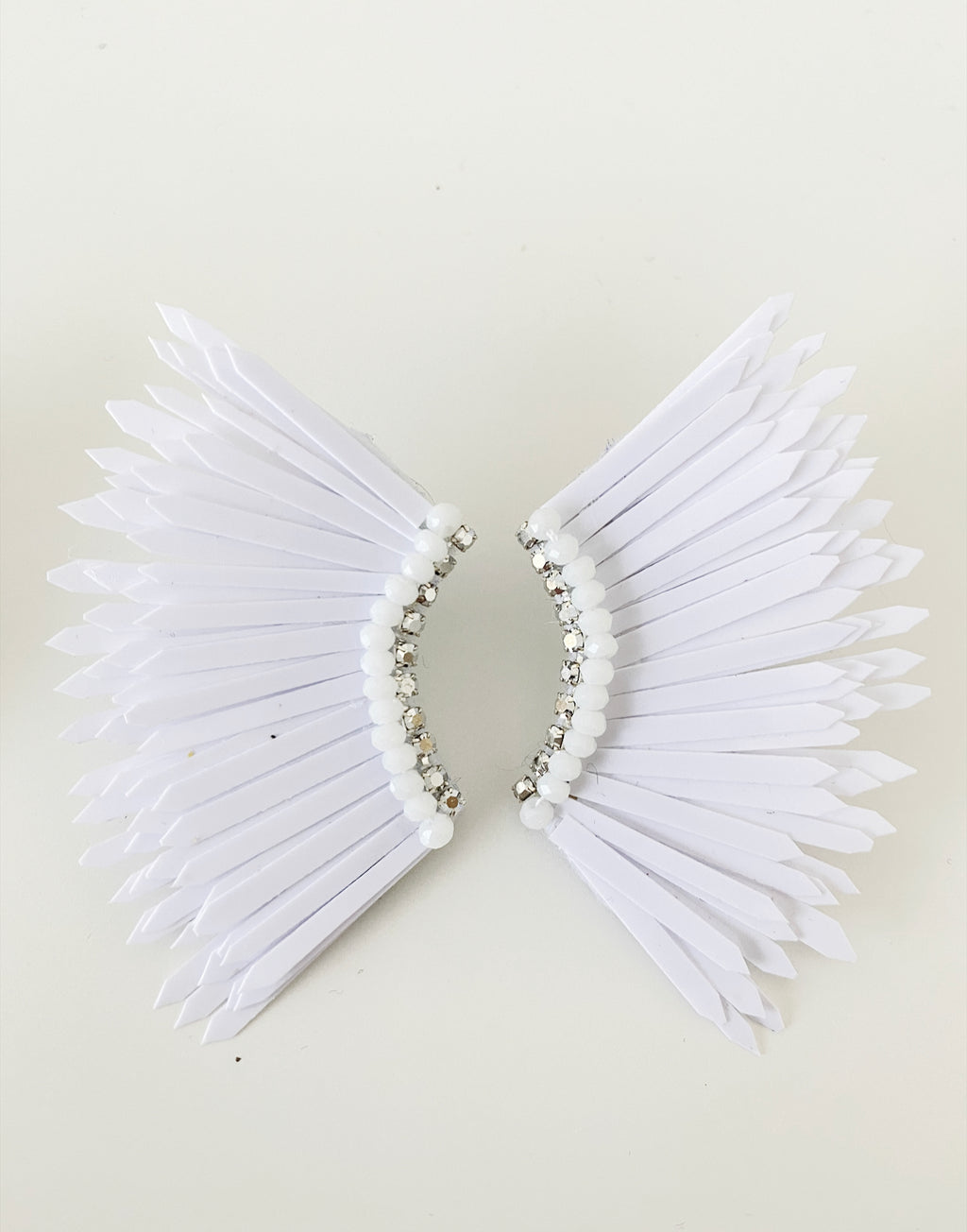 Small white wing earrings