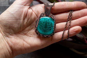 Copper Wire Wrapped Pendant with Stylized Flowers on Teal Fused Glass
