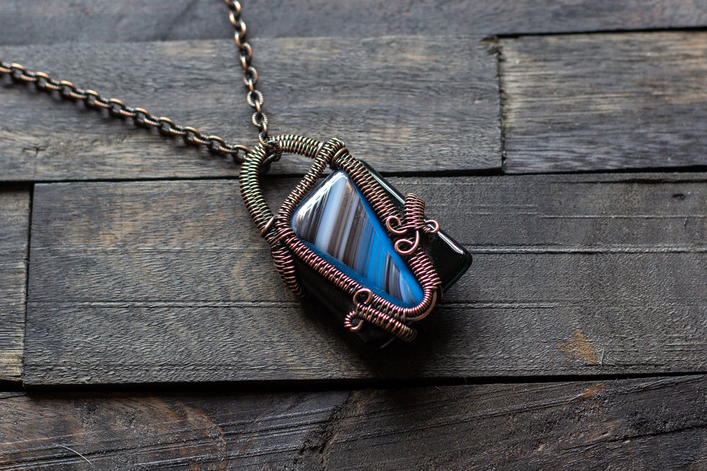 Black and Streaked Blue Glass Pendant with Copper Wire Wrapping