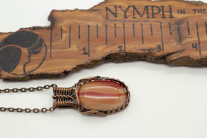 streaked-orange-fused-glass-pendant-copper-wire-wrapping-nymph-in-the-woods-jewelry