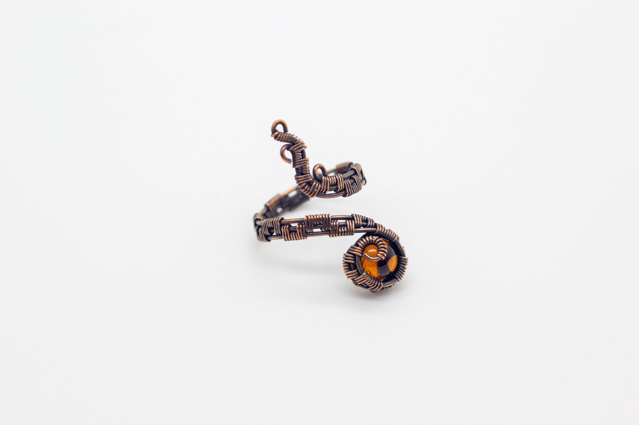handmade copper wire wrapped adjustable ring with transparent amber fused glass accent