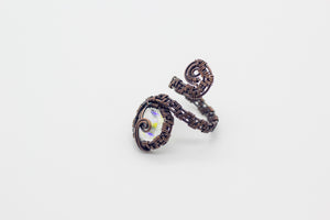 handmade copper wire wrapped adjustable ring with clear iridescent fused glass accent