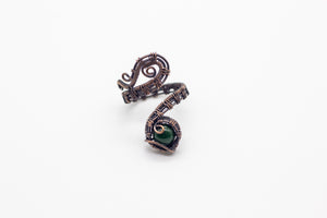 handmade copper wire wrapped adjustable ring with dark green fused glass accent