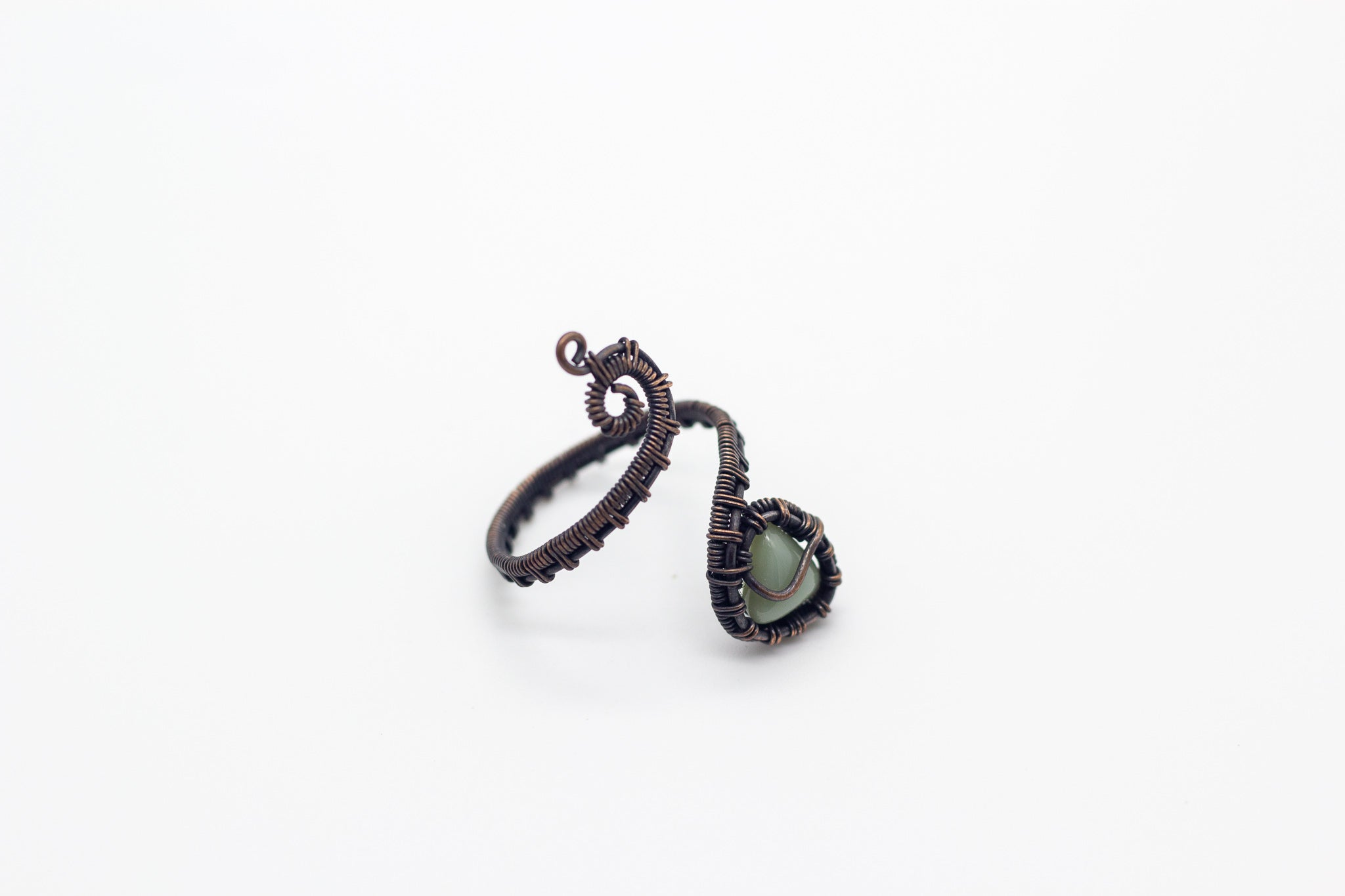 handmade copper wire wrapped adjustable ring with pale green fused glass accent