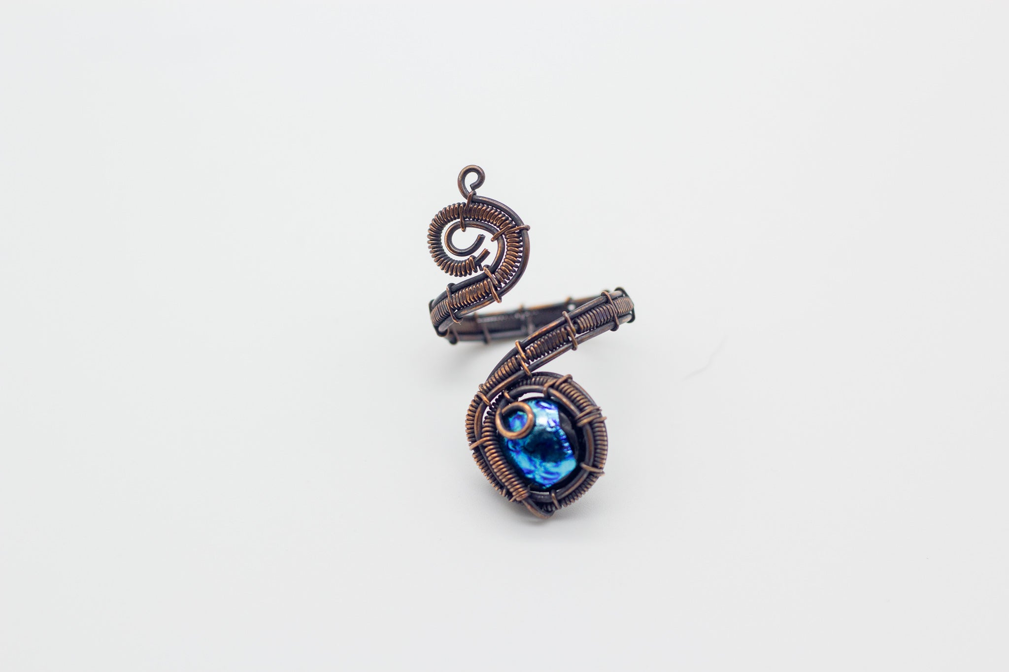 handmade copper wire wrapped adjustable ring with bright blue fused glass accent