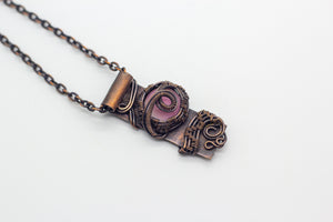 handmade copper bar necklace with pink fused glass and wire wrapping