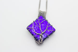 handmade sterling silver tree of life pendant with bright blue fused glass