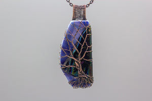 large handmade copper tree of life pendant on dichroic black and blue fused glass