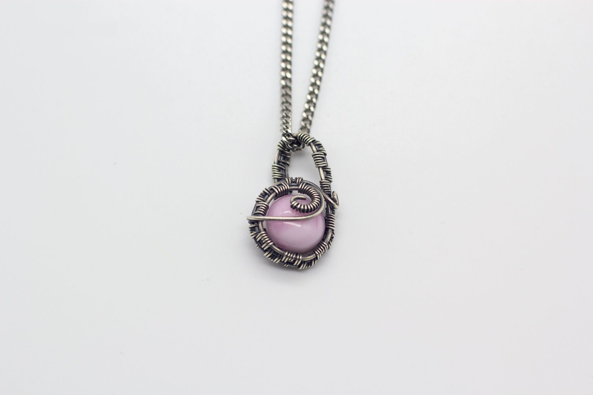 handmade small pendant with pink fused glass and sterling silver wire wrapping