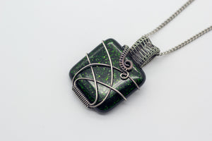 handmade dichroic green fused glass and sterling silver wire wrapped pendant